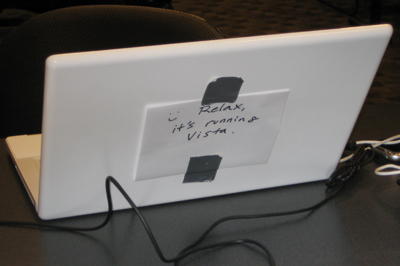 MacBook with a note over the logo to highlight that Vista is the running OS